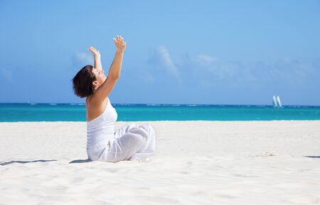 meditation of happy woman in lotus pose on the beach Stock Photo - 6942463