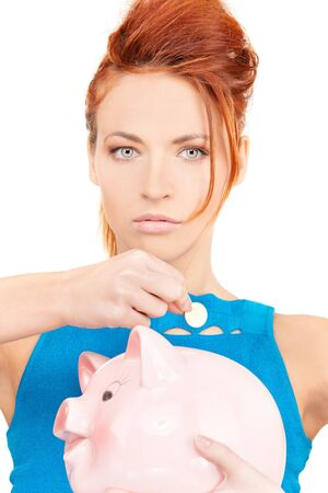 picture of lovely woman with piggy bank photo
