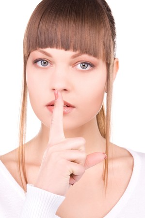 bright picture of young woman with finger on lips Stock Photo - 6943001