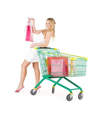 happy woman with shopping bags and cart over white Stock Photo - 6942792