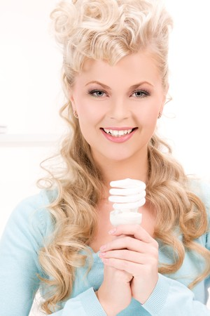 bright picture of woman holding energy saving bulb Stock Photo - 6943116