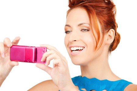 picture of happy woman using phone camera Stock Photo - 6942816
