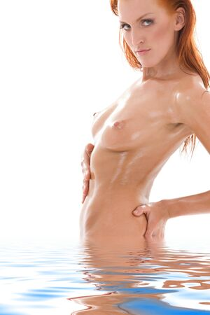 picture of healthy naked redhead in water Stock Photo - 6942985