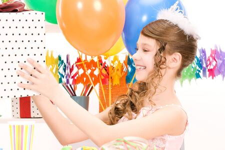 happy party girl with balloons and gift box Stock Photo - 7010156