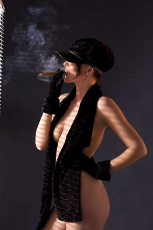 sexy woman in black astrakhan smoking cigar Stock Photo - 7010286