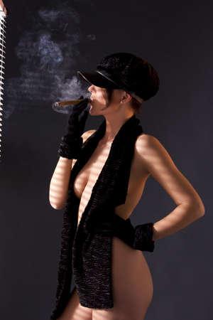 sexy woman in black astrakhan smoking cigar Stock Photo - 7010286