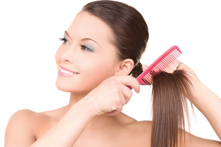 bright picture of beautiful woman with comb Stock Photo - 7010330