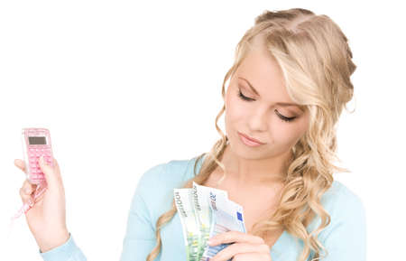 happy woman with calculator and money over white Stock Photo - 7010273