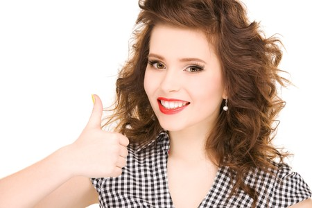 bright picture of lovely woman with thumbs up Stock Photo - 7010461