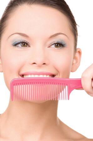 bright picture of beautiful woman with comb Stock Photo - 7010522