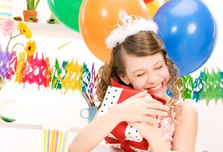 happy party girl with balloons and gift box