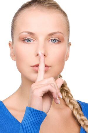 bright picture of teenage girl with finger on lips Stock Photo - 7039618