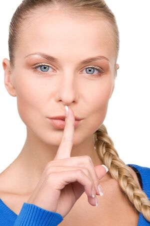 bright picture of teenage girl with finger on lips Stock Photo - 7070656