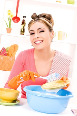 picture of beautiful housewife washing dish at the kitchen Stock Photo - 7070664