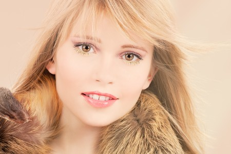 blond brown: picture of lovely teenage girl in brown fur