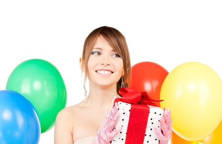 happy teenage party girl with balloons and gift box photo