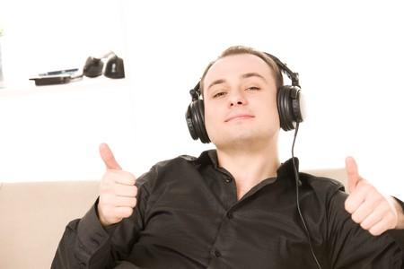 bright picture of happy man in headphones photo