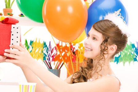 happy party girl with balloons and gift box Stock Photo - 7117165