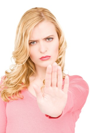 bright picture of young woman making stop gesture Stock Photo - 7117166