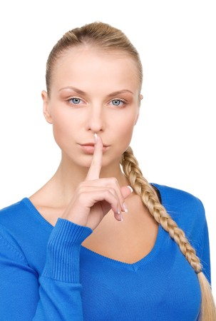 bright picture of teenage girl with finger on lips Stock Photo - 7117172
