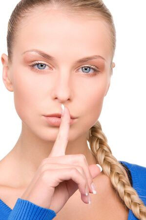 bright picture of teenage girl with finger on lips Stock Photo - 7117297