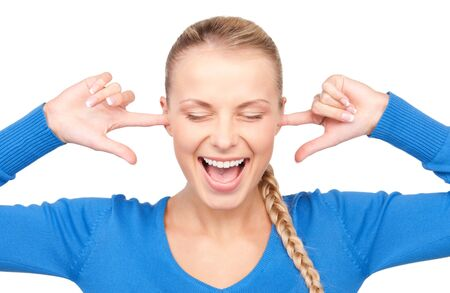 picture of smiling woman with fingers in ears Stock Photo - 7149838
