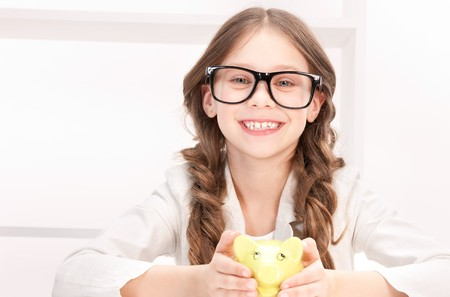 picture of little girl with piggy bank Stock Photo - 7149812