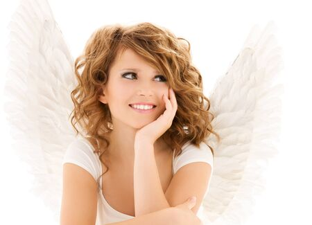 picture of happy teenage angel girl over white  photo