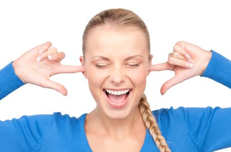 picture of smiling woman with fingers in ears Stock Photo - 7149856