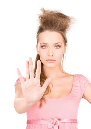 bright picture of young woman making stop gesture Stock Photo - 7218333