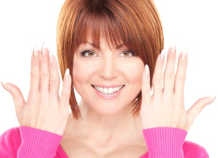picture of woman showing hands with polished nails