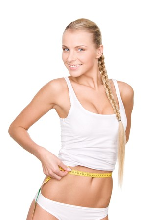 is slender: young beautiful woman with measure tape over white Stock Photo