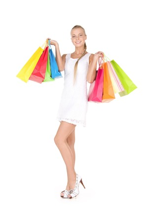 fashion bag: lovely woman with shopping bags over white