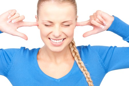 picture of smiling woman with fingers in ears Stock Photo - 7327970