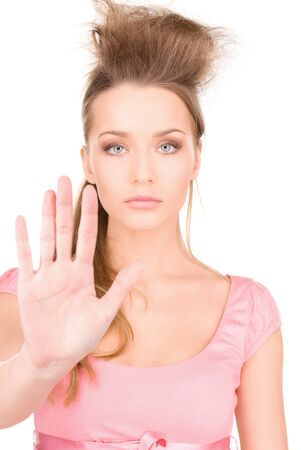 bright picture of young woman making stop gesture Stock Photo - 7327935