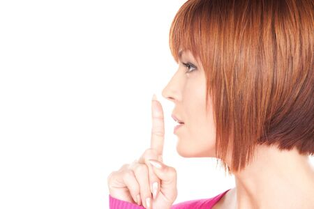 bright picture of businesswoman with finger on lips  photo