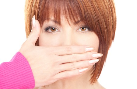 shh: bright picture of busenesswoman with hand over mouth Stock Photo