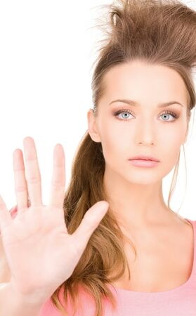 bright picture of young woman making stop gesture Stock Photo - 7347014