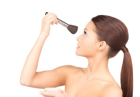 lovely woman with powder and brush over white Stock Photo - 7346821
