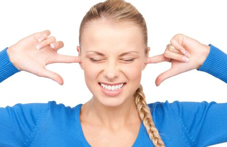 picture of smiling woman with fingers in ears Stock Photo - 7347085