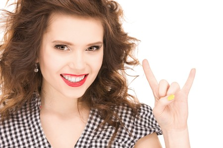 picture of happy teenage girl showing devil horns gesture photo