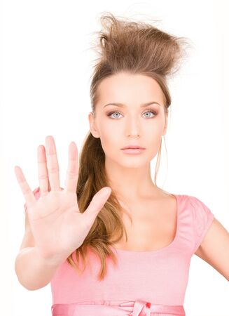 bright picture of young woman making stop gesture Stock Photo - 7347098