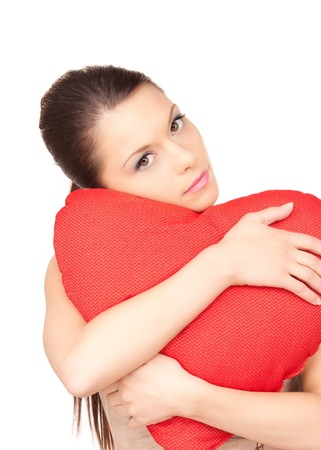 red pillows: lovely woman with red heart-shaped pillow over white