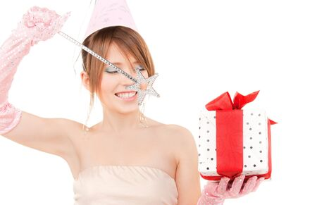 happy teenage party girl with magic wand and gift box (focus on items) photo