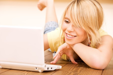 picture of teenage girl with laptop computer photo