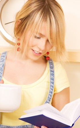 homestudy: picture of teenage girl with book and mug