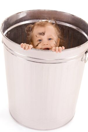 uncombed: picture of adorable baby in trash can