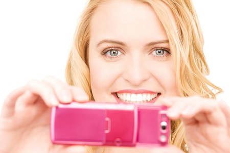 picture of happy woman using phone camera photo