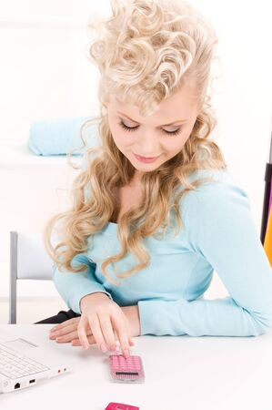 picture of lovely woman with calculator and computer photo