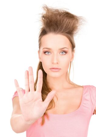 bright picture of young woman making stop gesture Stock Photo - 7347093